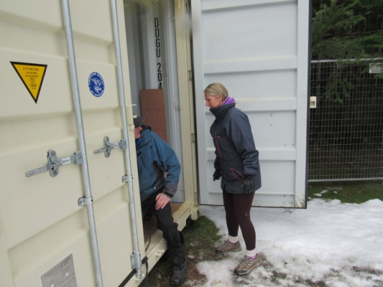 Natural history volunteers check on and maintain the collection in the storage containers.